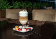Coffee Latte in Transparent Glass silver in Cafe, Latte Macchiat Royalty Free Stock Image