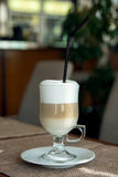 Coffee Latte in Transparent Glass silver in Cafe, Latte Macchiat Royalty Free Stock Images