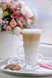 Coffee Latte in Transparent Glass silver in Cafe, Latte Macchiat Stock Image