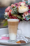 Coffee Latte in Transparent Glass silver in Cafe, Latte Macchiat Stock Images