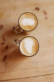 Coffee latte in two tall glasses on wood Stock Photos