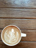 Coffee latte on wood table. Coffee latte in white cup on wood table background Royalty Free Stock Photos