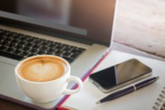 Coffee latte on work table Royalty Free Stock Image
