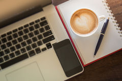 Coffee latte on work table Royalty Free Stock Photos