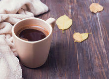 Coffee, leaves and blanket on the wooden background Stock Image