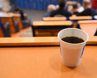 Coffee during lecture Royalty Free Stock Image
