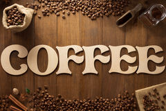 Coffee letters and beans on wood Stock Images