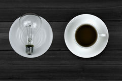 Coffee and light bulbs. Ideas are brewing Royalty Free Stock Image