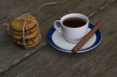 Coffee and linking of oatmeal cookies on the right Stock Image