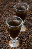 Coffee liqueur into a shot glass, selective focus Stock Photography