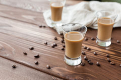 Coffee liqueury with coffee beans Royalty Free Stock Photos