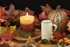 Coffee, Lit Candle and Pumpkin Decor Royalty Free Stock Photo