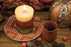 Coffee, Lit Candle and Pumpkin Decor Stock Images