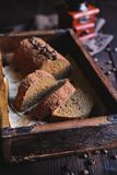 Coffee loaf cake studded with cocoa powder stock images