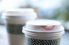 Coffee love. Lipstick imprint on the lid of a disposable coffee cup Royalty Free Stock Photography