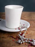 Coffee with love. Coffee cup with glitter hearts on a old wooden table Stock Photography