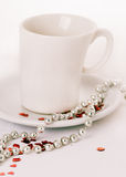 Coffee with love. Coffee cup on a white background with red glitter hearts Stock Photos
