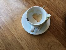 Coffee love. Empty coffeecup with a heart in the residues door Stock Photo