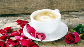 Coffee love with roses on milk, Latte coffee art Stock Image
