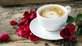Coffee love with roses on milk, Latte coffee art Royalty Free Stock Image