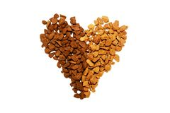 Grains of coffee arranged in a heart shape stock images
