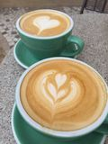 Coffee lover. Enjoying our morning Latte at a corner bistro Royalty Free Stock Photos