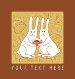 Coffee lovers. Two white rabbits with cup of coffee Stock Photos