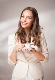 Coffee loving brunette. Royalty Free Stock Photography
