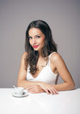 Coffee loving brunette. Royalty Free Stock Photo