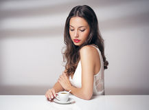 Coffee loving brunette. Stock Photos
