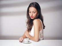 Coffee loving brunette. Stock Photos