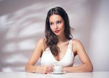 Coffee loving brunette. Royalty Free Stock Photo