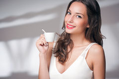 Coffee loving brunette. Royalty Free Stock Photos