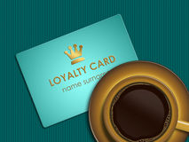 Coffee with loyalty card lying on tablecloth Stock Images