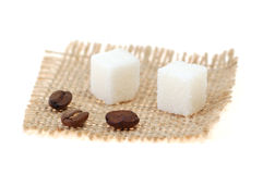 Coffee and lump sugar. Coffee beans and lump sugar on sackcloth stock photos