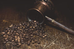 Coffee. Lying on Jazzve scattered coffee granules Royalty Free Stock Photography