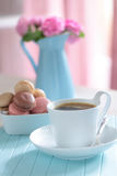 Coffee and macarons Stock Images