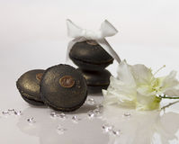 Coffee macarons. Black Coffe macarons with diamonds,flower and white ribbon Royalty Free Stock Images