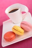 Coffee and macaroon Stock Photos