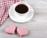 Coffee and macaroons. Morning black coffee in a cup, with almond cookies Stock Photo