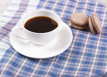Coffee and macaroons. Morning black coffee in a cup, with almond cookies Stock Photos