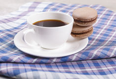 Coffee and macaroons. Morning black coffee in a cup, with almond cookies Royalty Free Stock Images