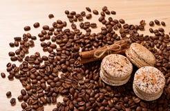 Coffee, macaroons and cinnamon Stock Photography