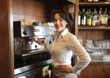 Coffee machine. Smiling waitress making coffee in a bar Royalty Free Stock Photography
