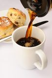 Coffee Machine. Fresh morning coffee being made the office canteen, with two scones in the background stock image