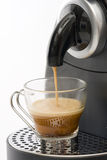 Coffee machine. Espresso machine dispensing coffee into a glass cup Royalty Free Stock Photography