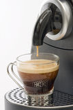 Coffee machine. Espresso machine dispensing coffee into a glass cup Royalty Free Stock Photos