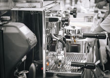 Coffee machine and barista in Restaurant cafe Royalty Free Stock Images