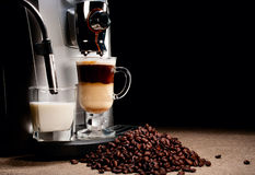 Coffee machine and beans heap Royalty Free Stock Photos