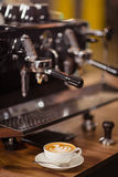 Coffee machine and cappuccino royalty free stock photos
